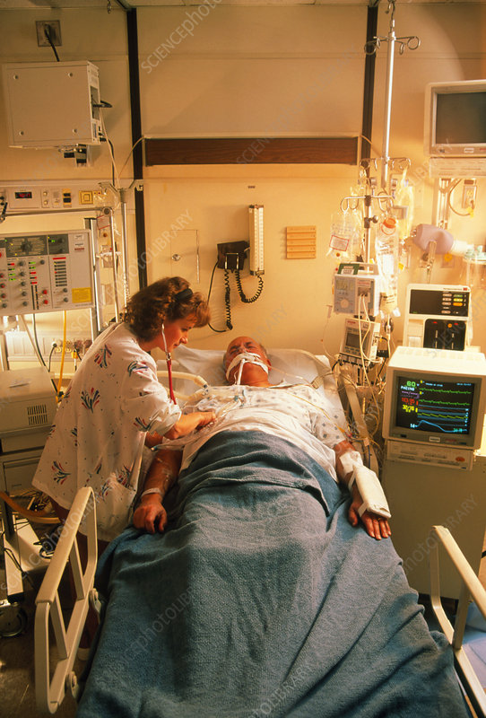 Nurse with an elderly patient in intensive care