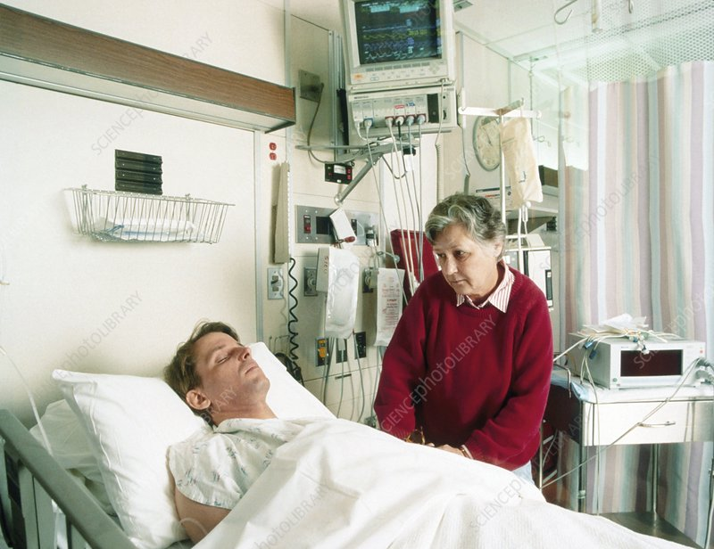 Mother visiting her son in an intensive care unit