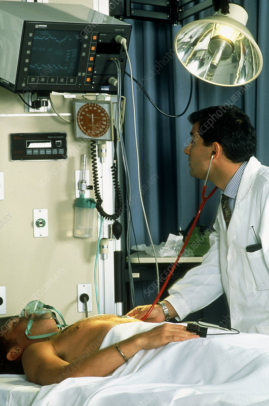 Doctor with a male patient in intensive care
