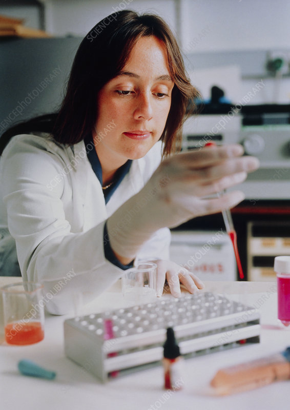 Technician doing haemagglutination test on blood