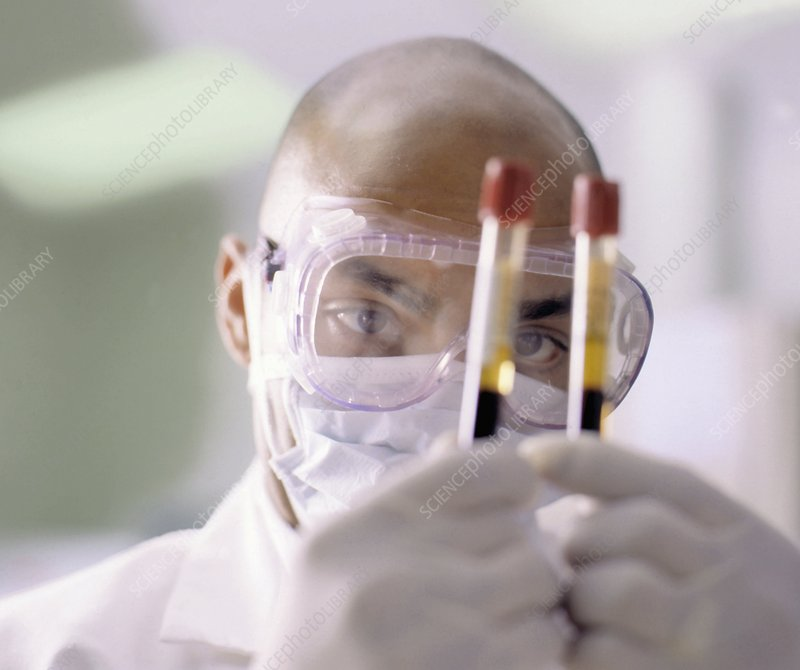 Technician with blood samples in centrifuge tubes