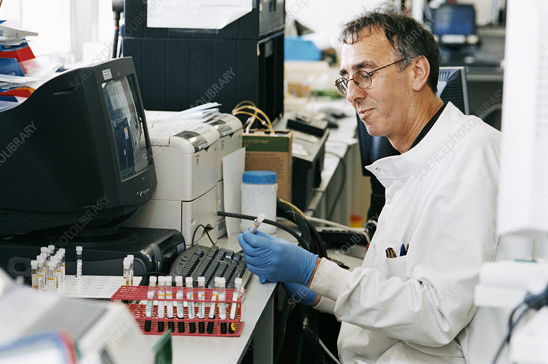 Pathologist in his lab