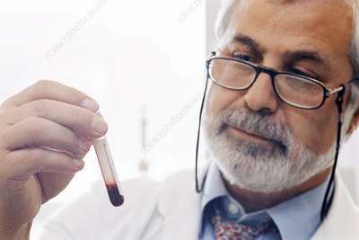 Pathologist analysing sample