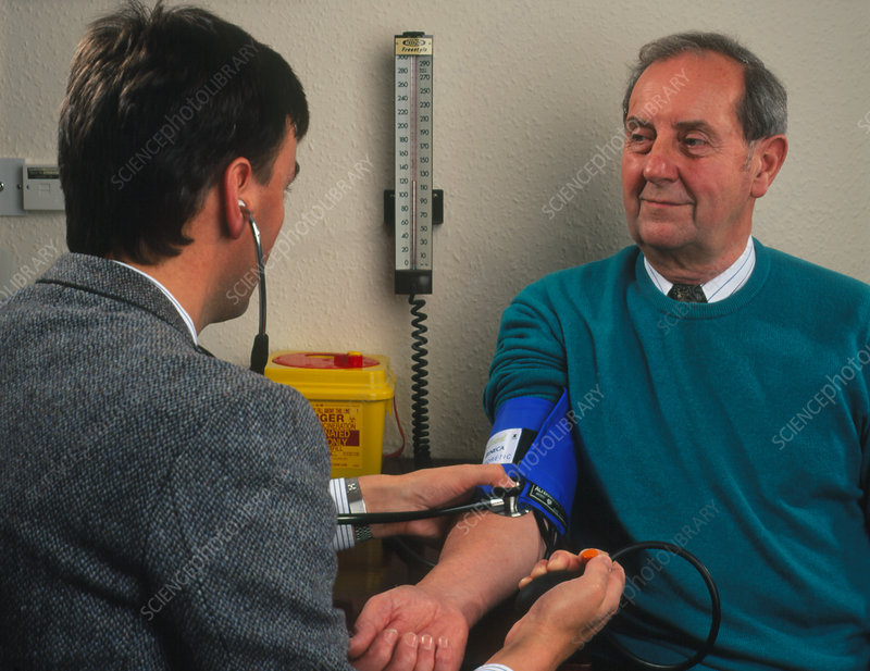GP doctor measures blood pressure of elderly man