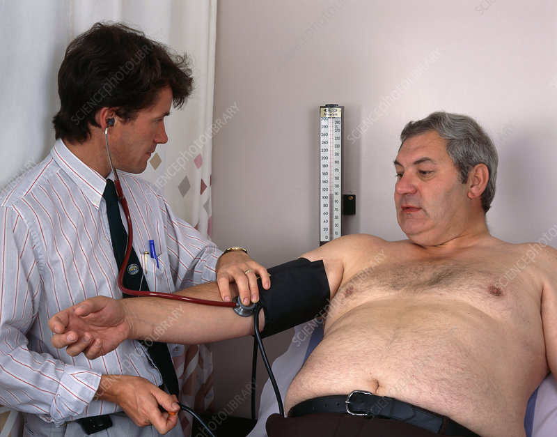 Doctor takes the blood pressure of an obese man