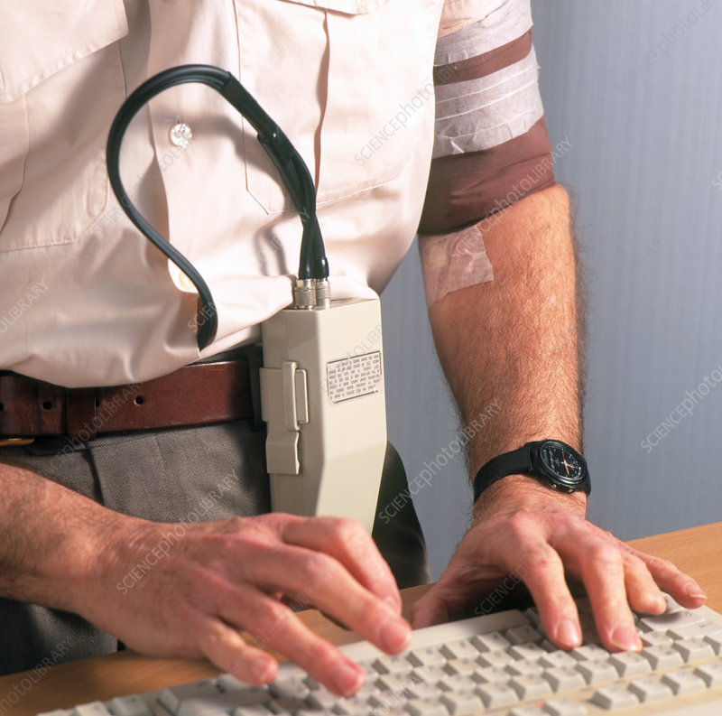 Man wearing ambulatory blood pressure monitor