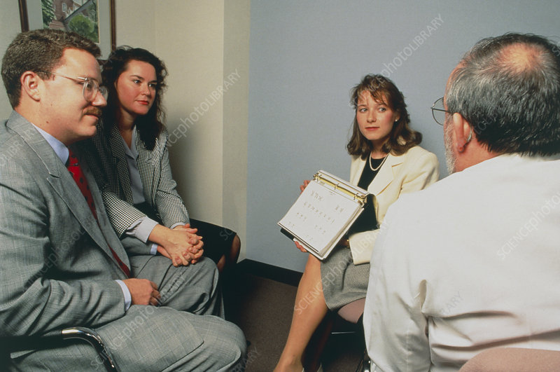 Doctor and genetic counsellor talking with couple