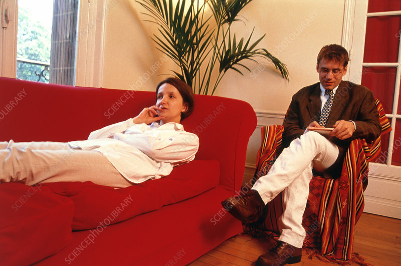 Woman lying on a couch undergoing psychoanalysis - Stock ...