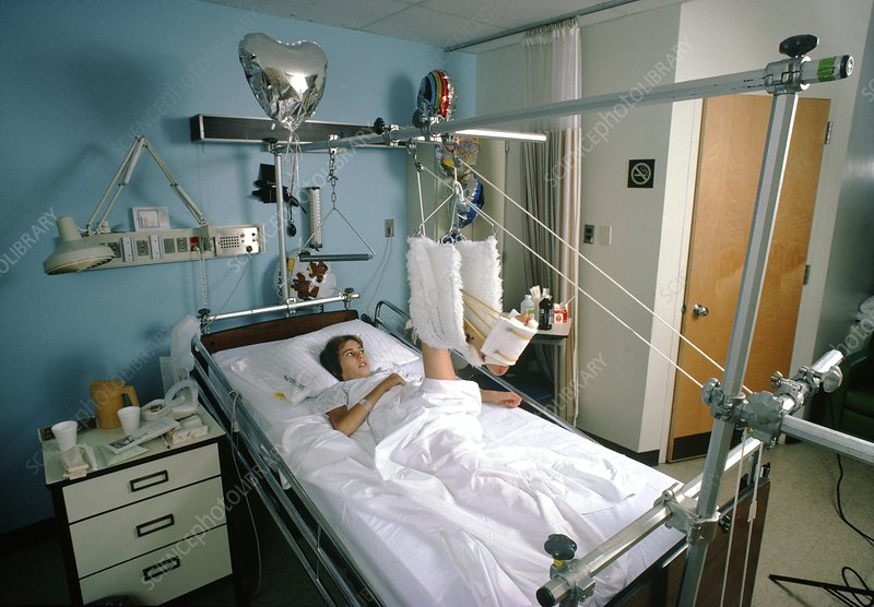 Young woman lying in hospital bed