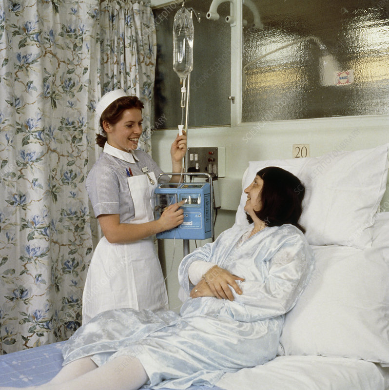 Nurse setting up an infusion pump.