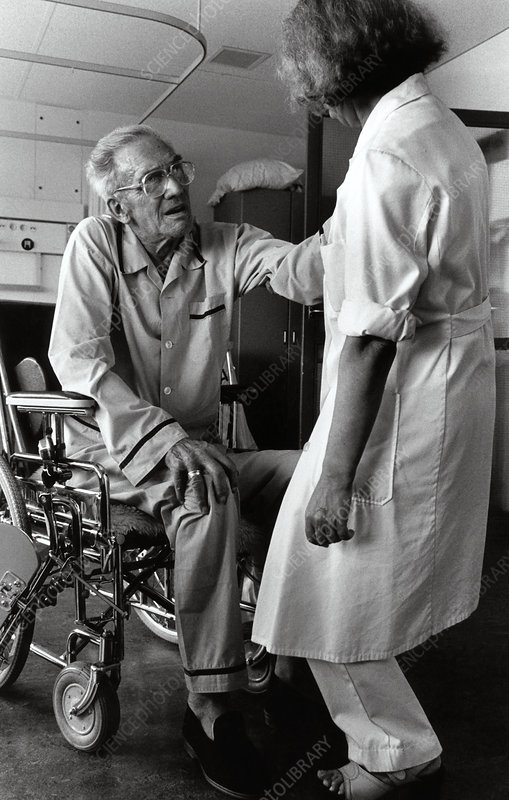 Nurse with elderly man in wheelchair