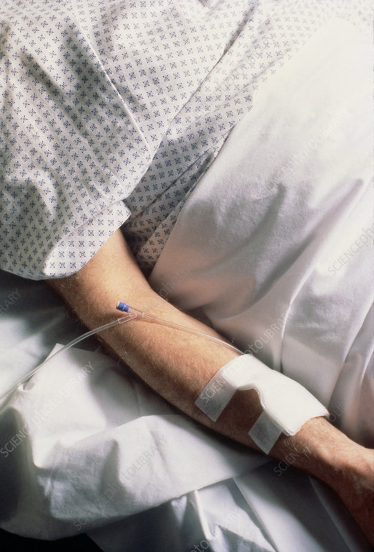 Arm of hospital patient receiving IV drip