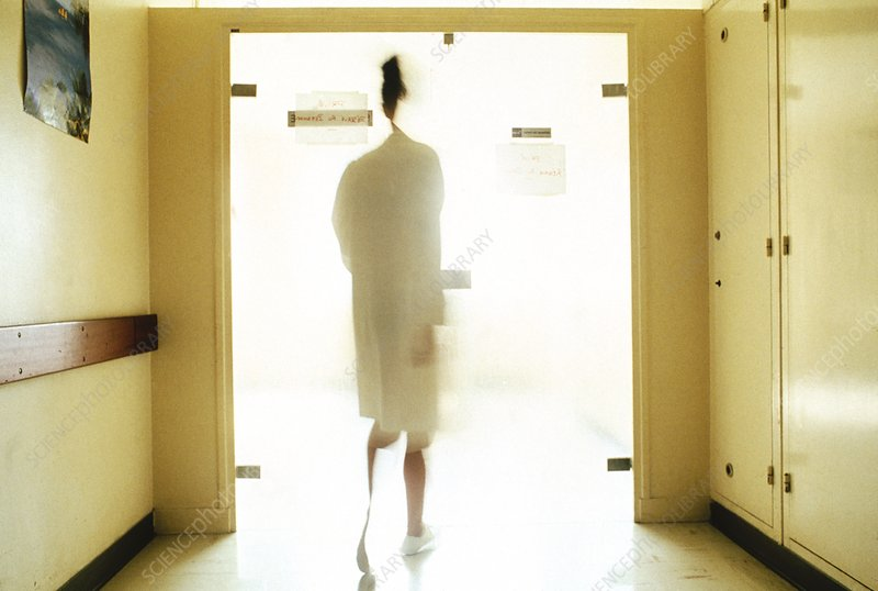 Nurse walking down a hospital corridor