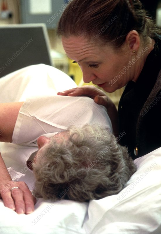 View of a nurse comforting an elderly woman