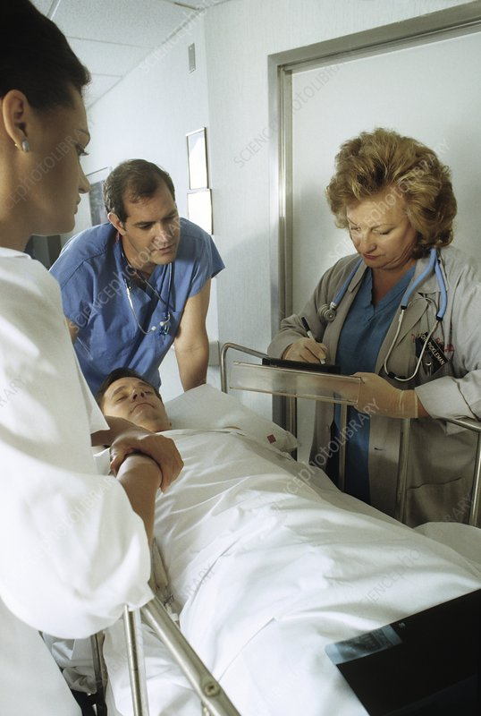 View of a male patient being transferred to a ward