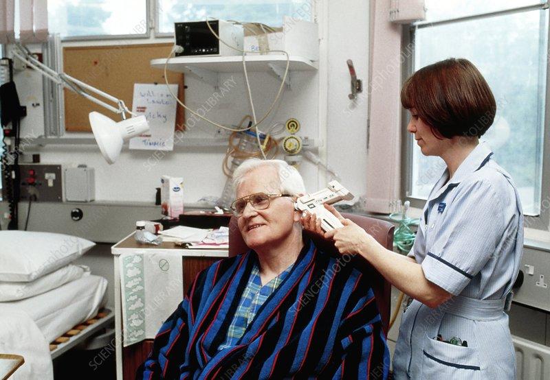 Nurse measuring patient's temperature