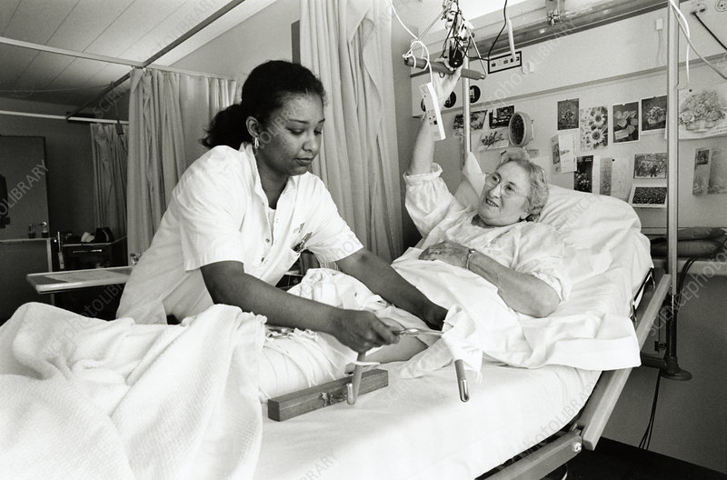 Hospital nurse and patient