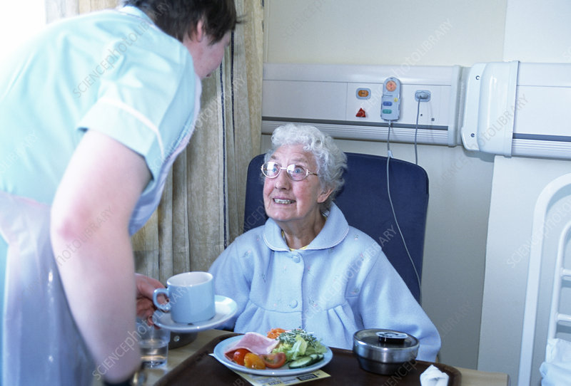 Hospital patient being served food