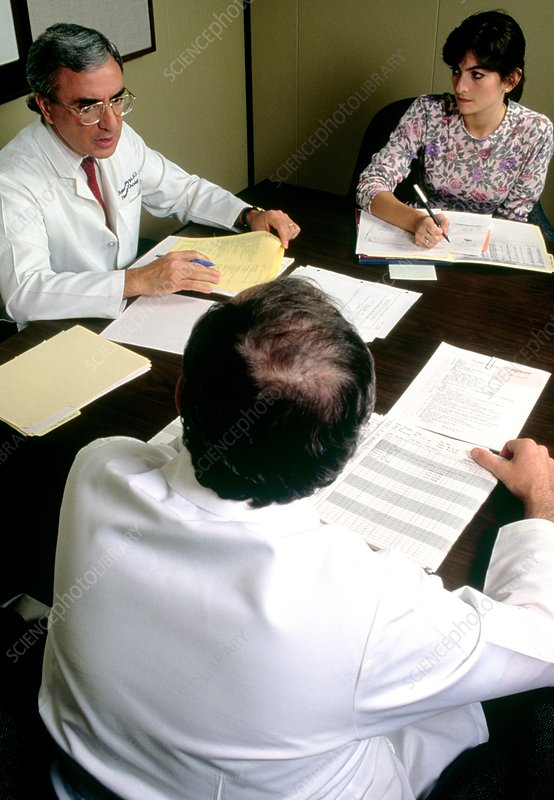 Medical staff at a case review group