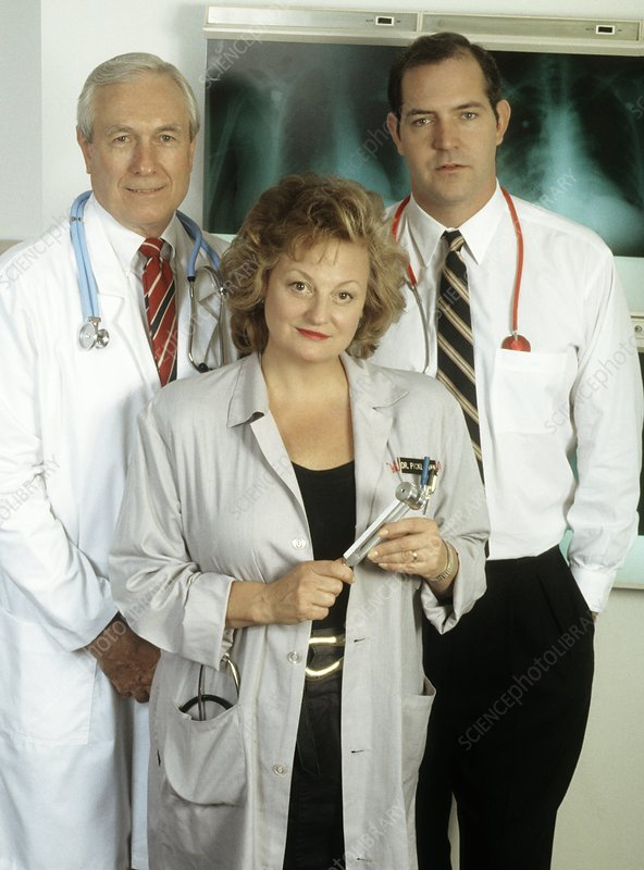 Portrait of three doctors at hospital work station