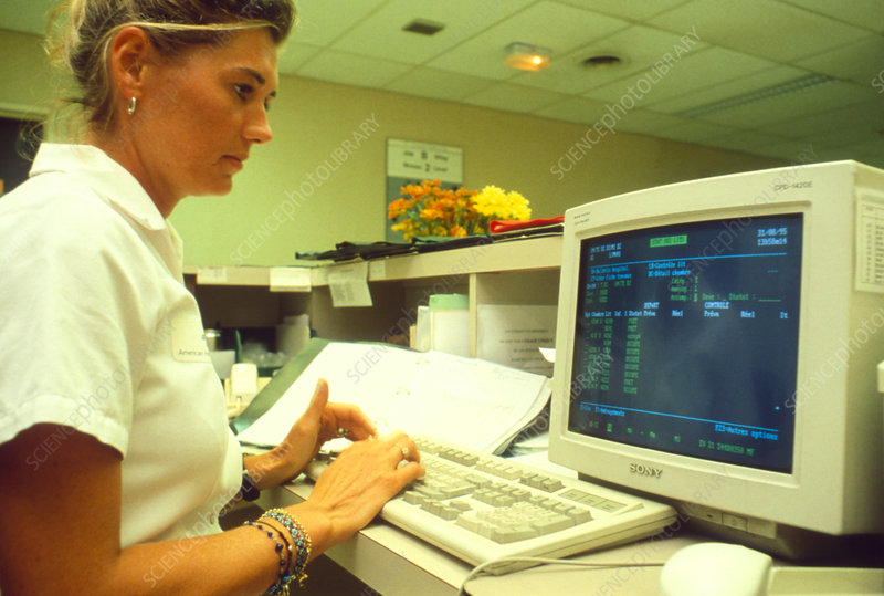 Nurse works on a computer at a workstation