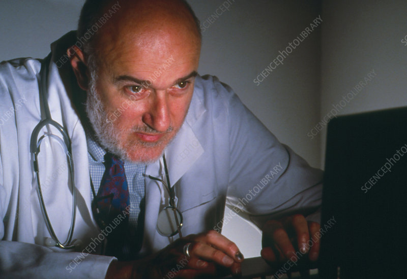 Doctor at a computer workstation