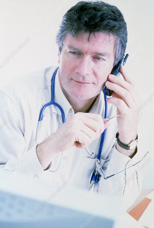 Doctor on telephone
