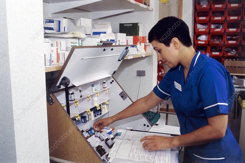 Hospital nurse taking drugs inventory