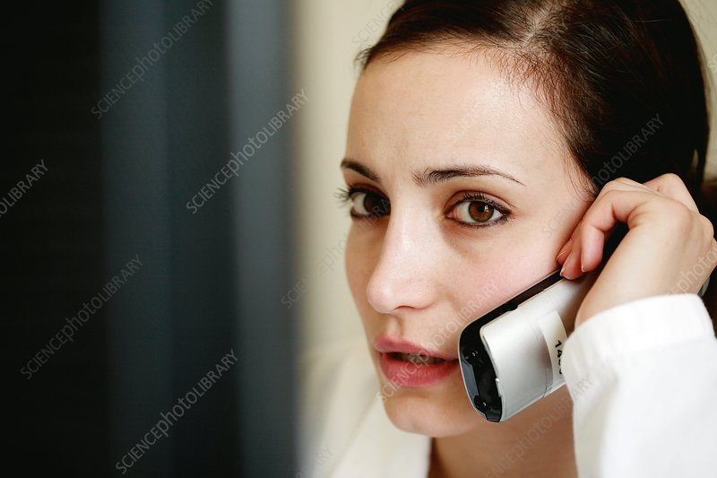 Doctor using a telephone