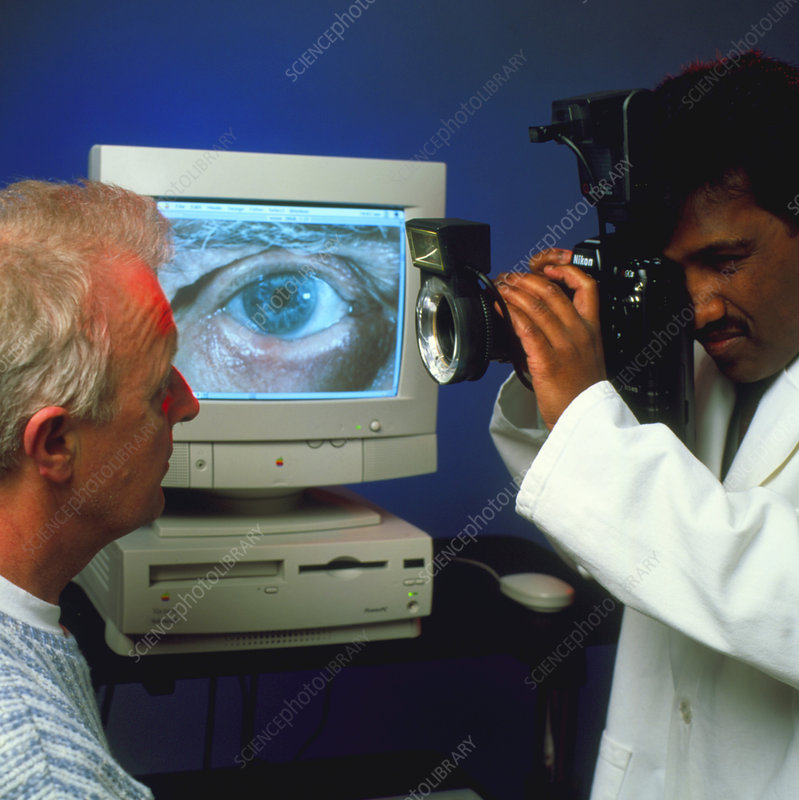 Doctor photographs man's eye for digital records