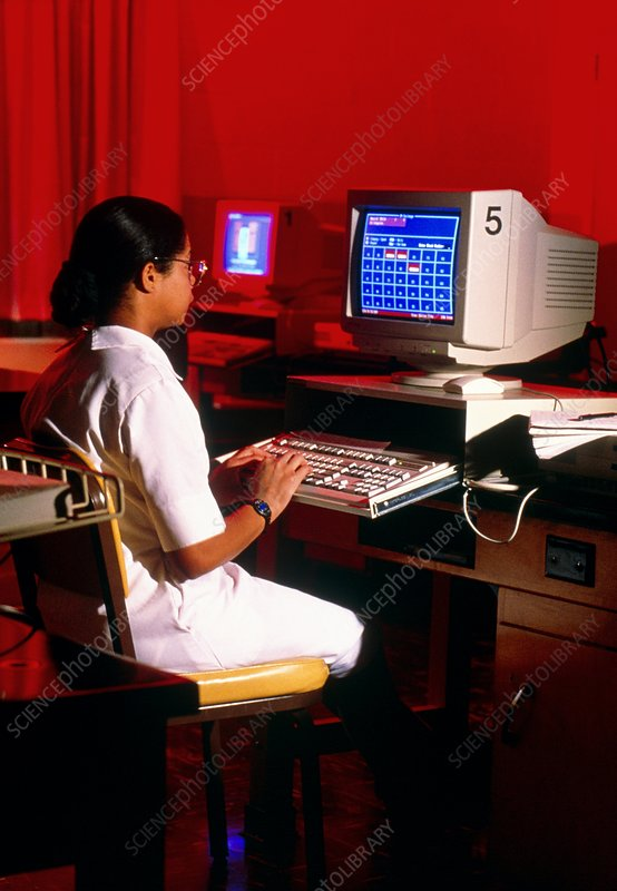 Student nurse views medical records on a computer