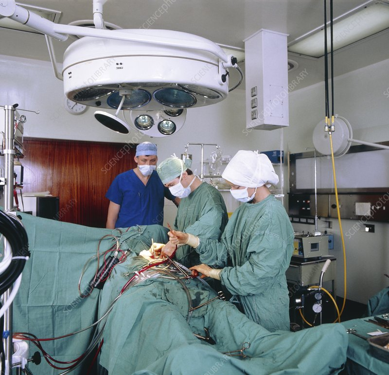 Surgeons closing-up at end of thoracic op