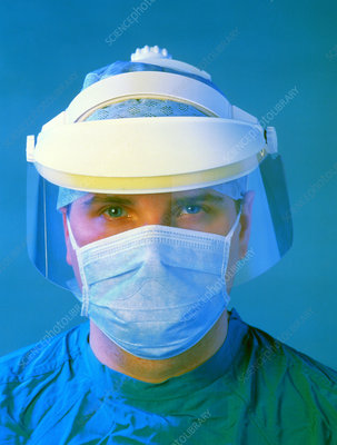 Surgeon wearing plastic face mask