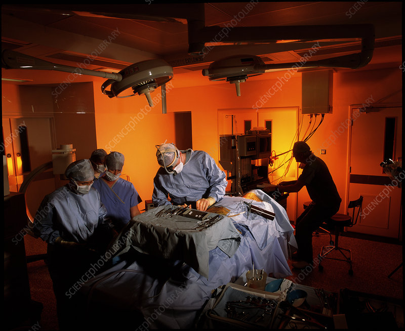 Surgical team performing a neck fusion operation
