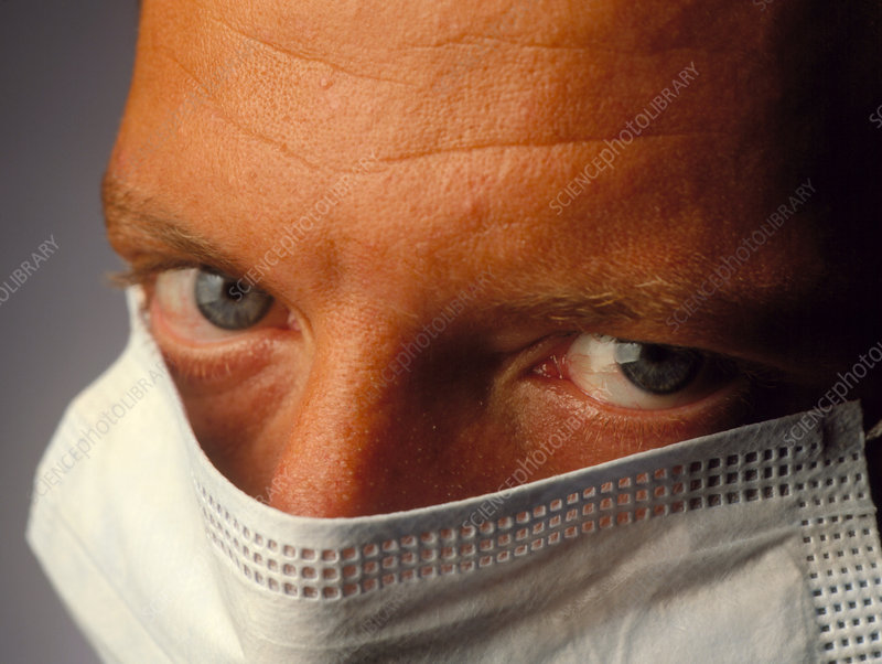 Masked face of a male surgeon