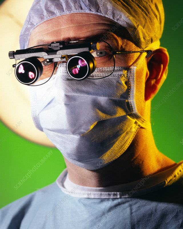 Surgeon with magnifying lenses for microsurgery
