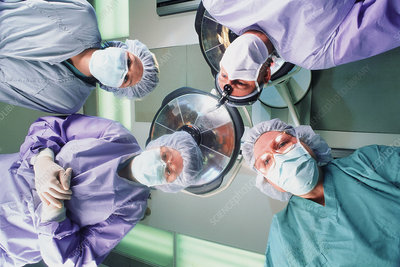 Patient's eye view of a surgical team