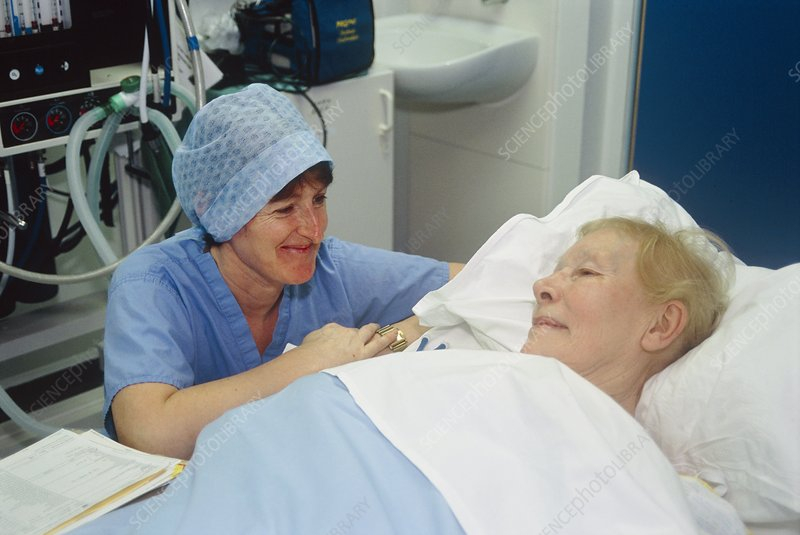 Operating theatre nurse with a patient