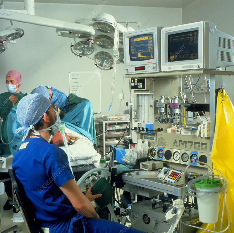 Anaesthetist monitoring the condition of a patient