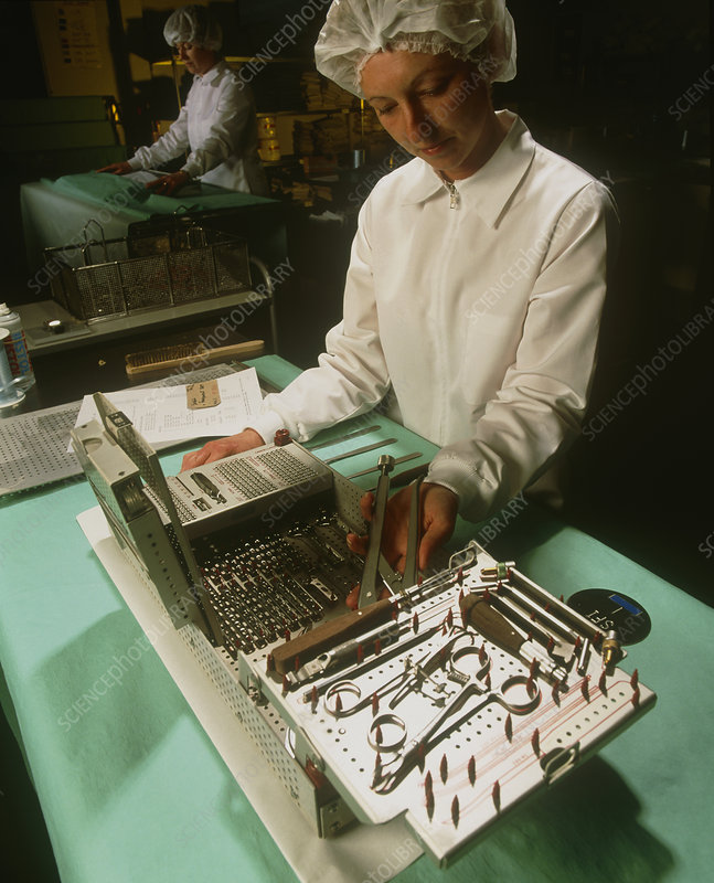 Medical technician preparing surgical instruments