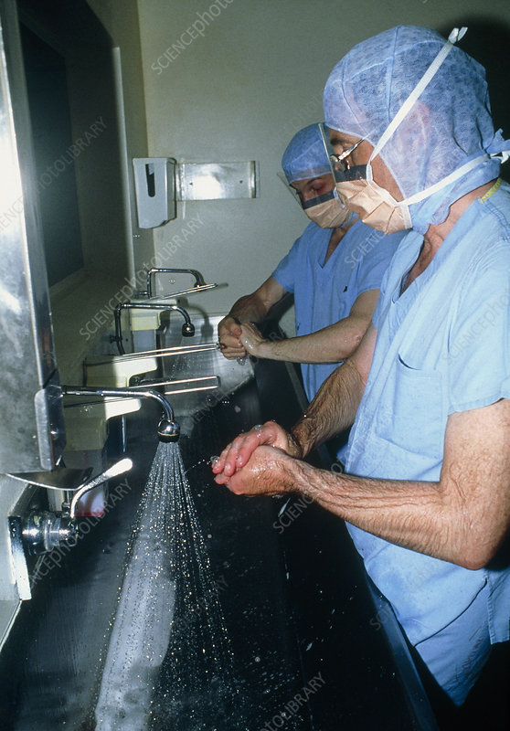 Surgeons scrubbing hands before operation