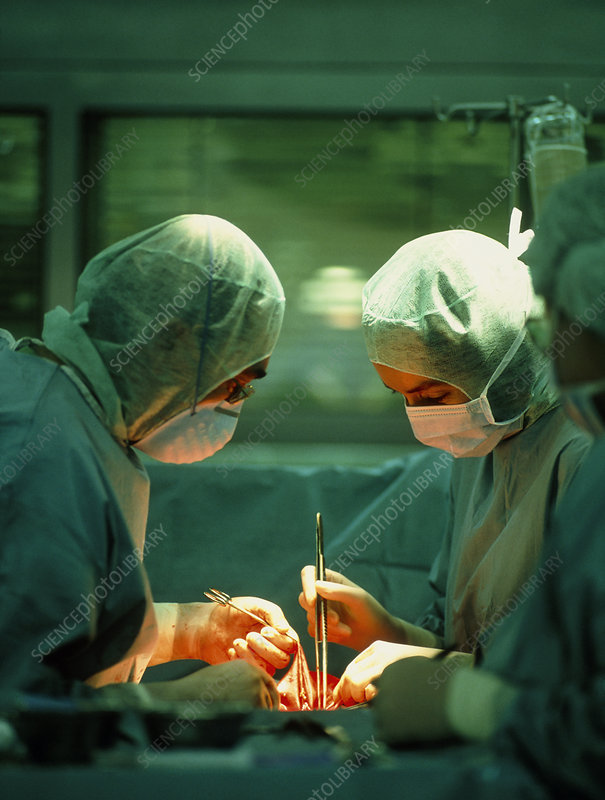 Surgical team conducting open heart surgery