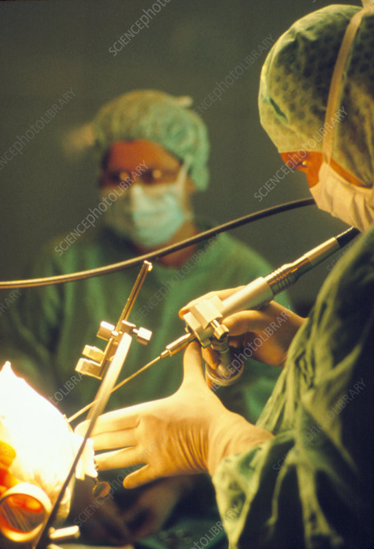 Neurosurgeon performs brain biopsy on a patient