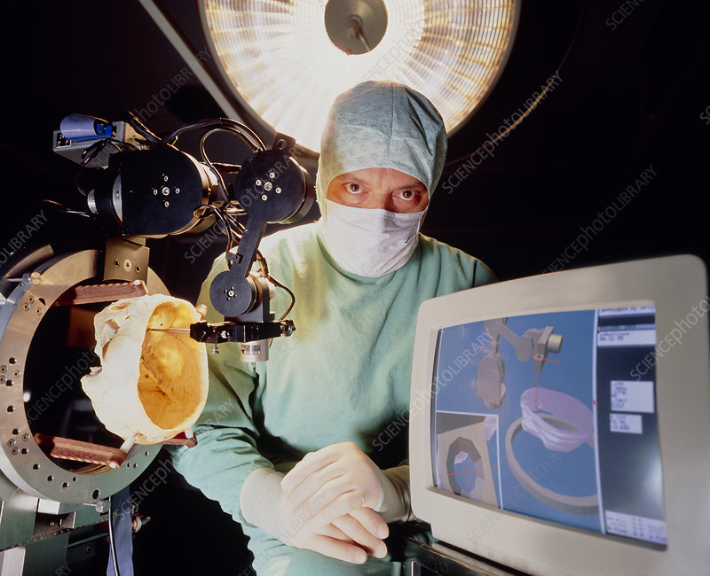 Neurosurgeon with robot for brain surgery