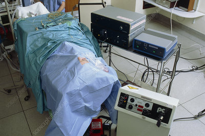 Patient on operating table awaiting eye surgery