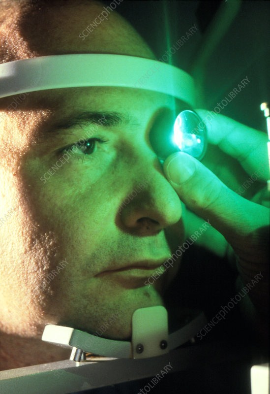Examination of a man's eye before surgery