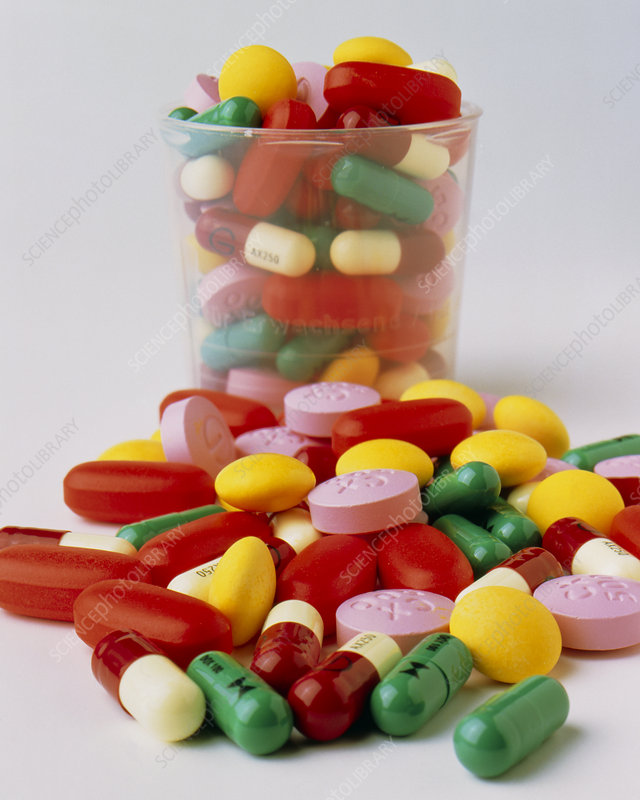 Assortment of antibiotic drugs, some in a cup