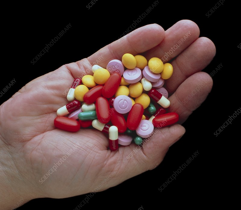 Assortment of antibiotic drugs held in a hand