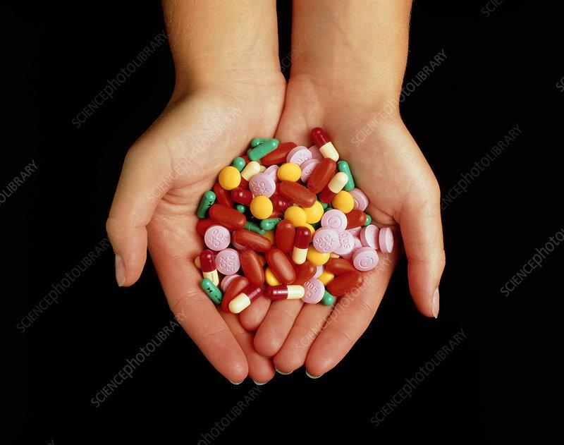 Assortment of antibiotic drugs held in hands
