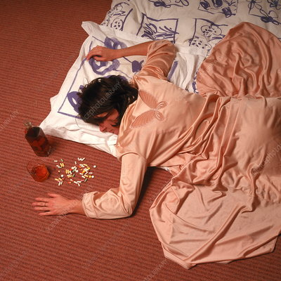Woman lying on the floor following a drug overdose